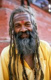 They are known, variously, as sadhus (saints, or 'good ones'), yogis (ascetic practitioners), fakirs (ascetic seeker after the Truth) and sannyasins (wandering mendicants and ascetics). They are the ascetic – and often eccentric – practitioners of an austere form of Hinduism. Sworn to cast off earthly desires, some choose to live as anchorites in the wilderness. Others are of a less retiring disposition, especially in the towns and temples of Nepal's Kathmandu Valley.<br/><br/>  If the Vale of Kathmandu seems to boast more than its share of sadhus and yogis, this is because of the number and importance of Hindu temples in the region. The most important temple of Vishnu in the valley is Changunarayan, and here the visitor will find many Vaishnavite ascetics. Likewise, the most important temple for followers of Shiva is the temple at Pashupatinath. Vishnu, also known as Narayan, can be identified by his four arms holding a sanka (sea shell), a chakra (round weapon), a gada (stick-like weapon) and a padma (lotus flower). The best-known incarnation of Vishnu is Krishna, and his animal is the mythical Garuda.<br/><br/>  Shiva is often represented by the lingam, or phallus, as a symbol of his creative side. His animal is the bull, Nandi, and his weapon is the trisul, or trident. According to Hindu mythology Shiva is supposed to live in the Himalayas and wears a garland of snakes. He is also said to smoke a lot of bhang, or hashish.